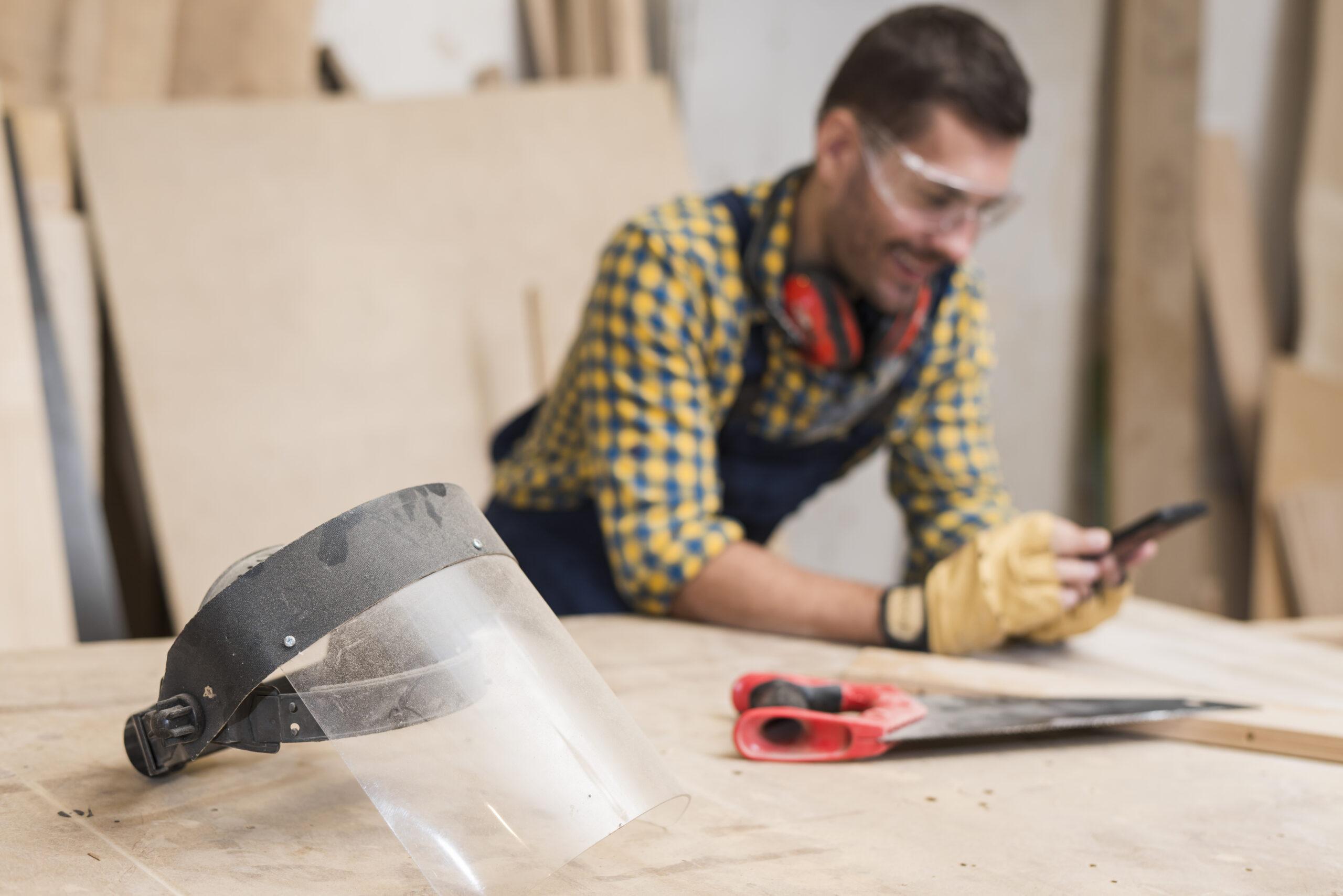 Tradesmen using mobile phone