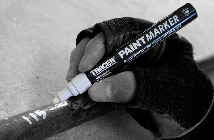 Paint marker used to mark metal pipe